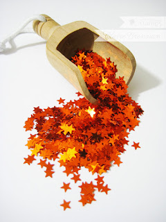 http://www.waltzingmousestamps.com/collections/new/products/orange-metallic-star-sequins#content