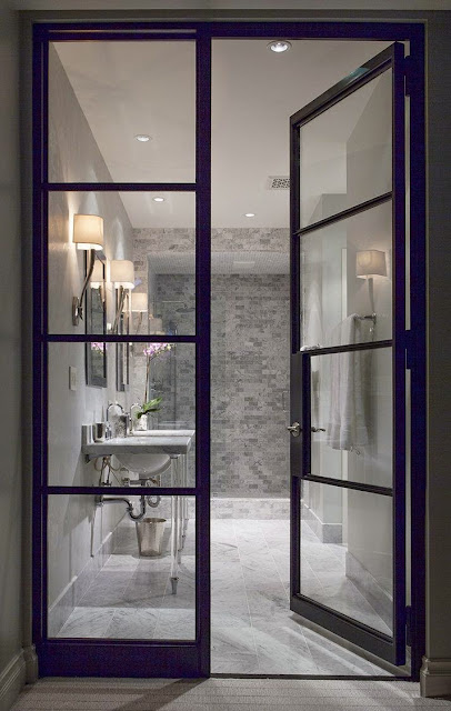 steel glass doors into master bathroom gray and whit subway tile