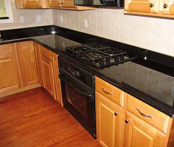 Backsplash ideas for black granite countertops the for Kitchen remodel ideas black granite