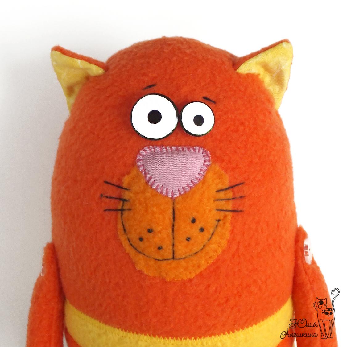 кот рыжий игрушка