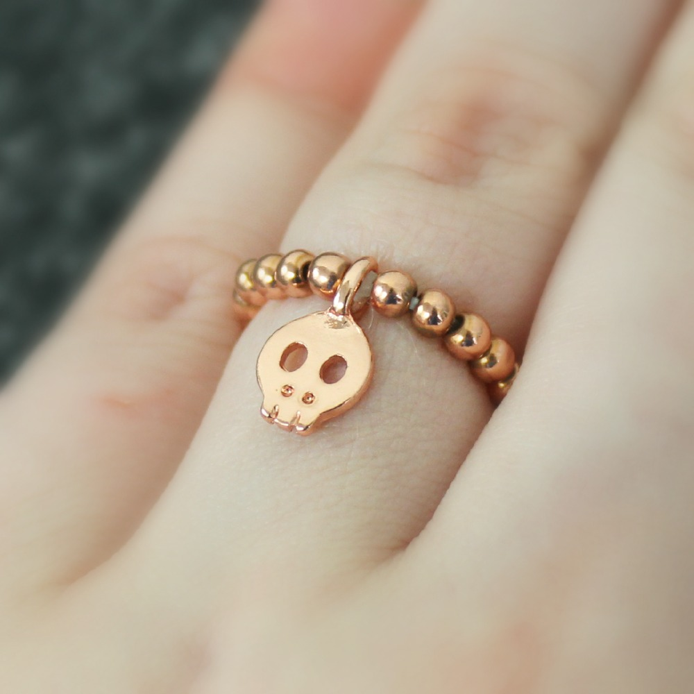 Rivkasmom Shoplately Stretch Skullie Ring rose gold skull ring