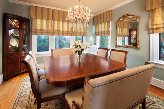 Stunning Crystal Chandelier in the Rustic Dining Space with Wooden Dining Room Tables And Chairs on Artistic Carpet