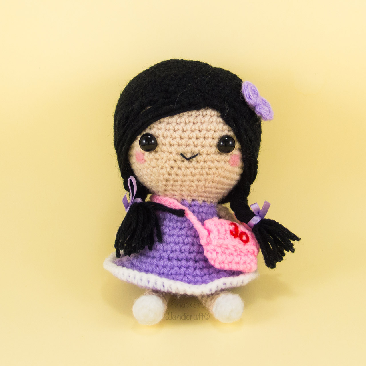 crocheted-girl-with-plaits-amigurumi