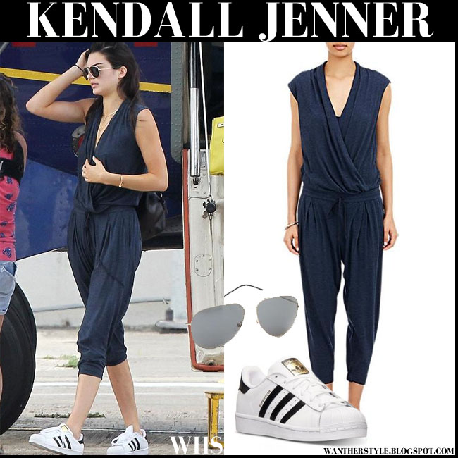 Kendall Jenner in blue Helmut Lang jumpsuit with white Adidas sneakers what she wore august 17