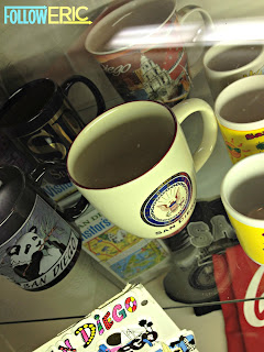 Souvenir coffee mugs featuring a U.S. Navy logo from San Diego, California
