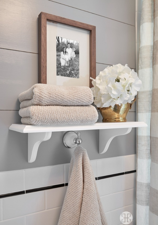 Beautiful white open shelving in neutral bathroom | A Well Dressed Home