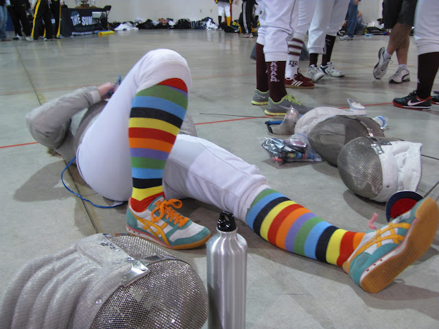 A fencer lays on the floor