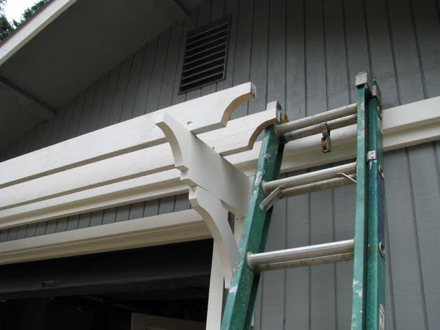 Blue roof cabin diy trellis over the garage door solutioingenieria Image collections