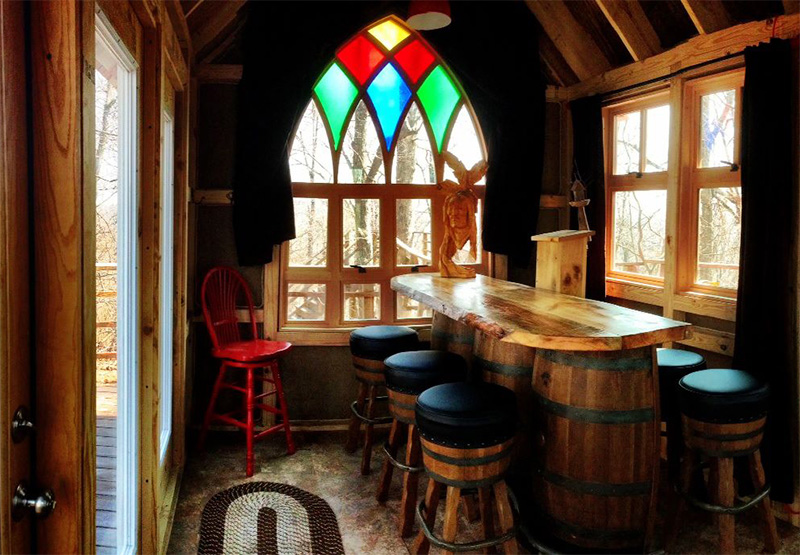 inside a custom bar was designed with old wine barrels a fully functional brewing set up and a european style draft system - Treehouse Masters Inside