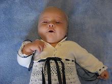 Gabriel så söt i sin dopklänning på sin dopdag.
