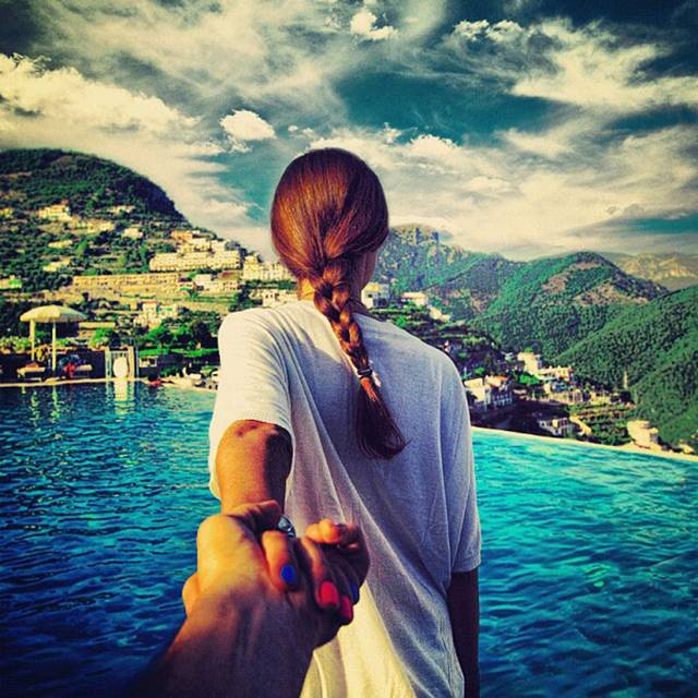 Photographer Murad Osmann creatively documents his travels around the world with his girlfriend leading the way in his ongoing series known as Follow Me To. Chronicling his adventures on Instagram, the Russian photographer composes each shot in a similar fashion. We see each landscape from the photographer's point of view with his extended hand holding onto his girlfriend's in front of him.