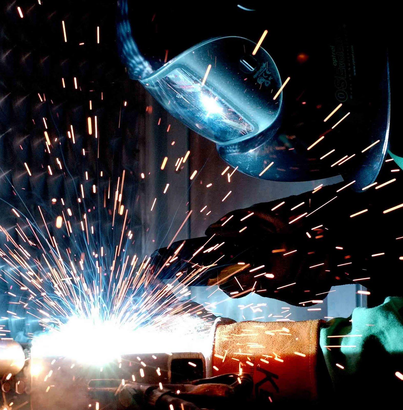 Pembuatan Pintu besi,Cannopy,Railing,Tangga & Konstruksi Baja