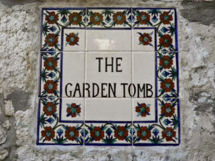 Sign outside the Garden Tomb which was believed to be owned by Joseph of Arimathaea. He was a wealthy man and owned a garden with a tomb cut out of the rock