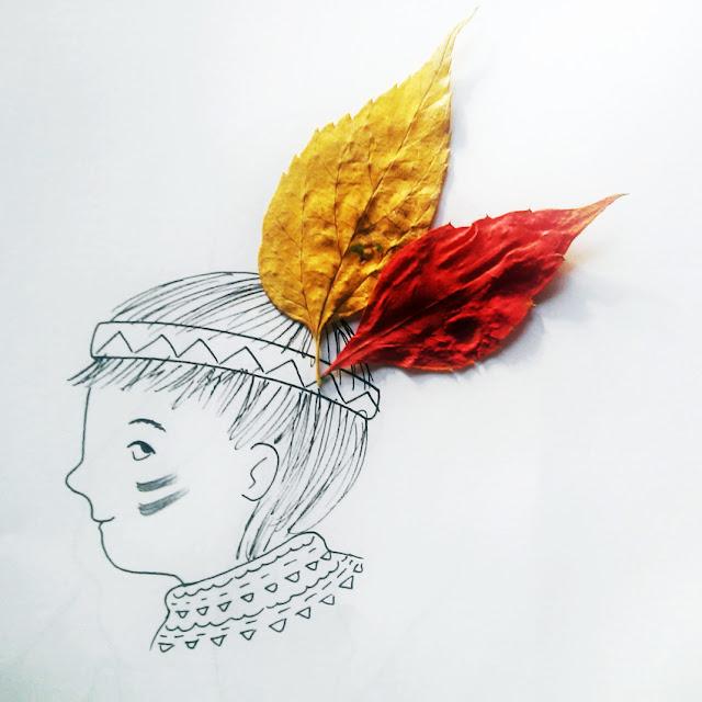 Niño indio con plumas de hojas secas