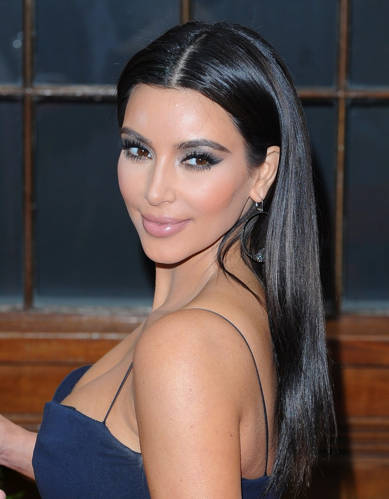 Kim Kardashian in Hot Photos in Blue Sleeveless Dress