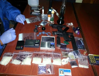 Houston HIDTA teams seize cash, guns and drugs.