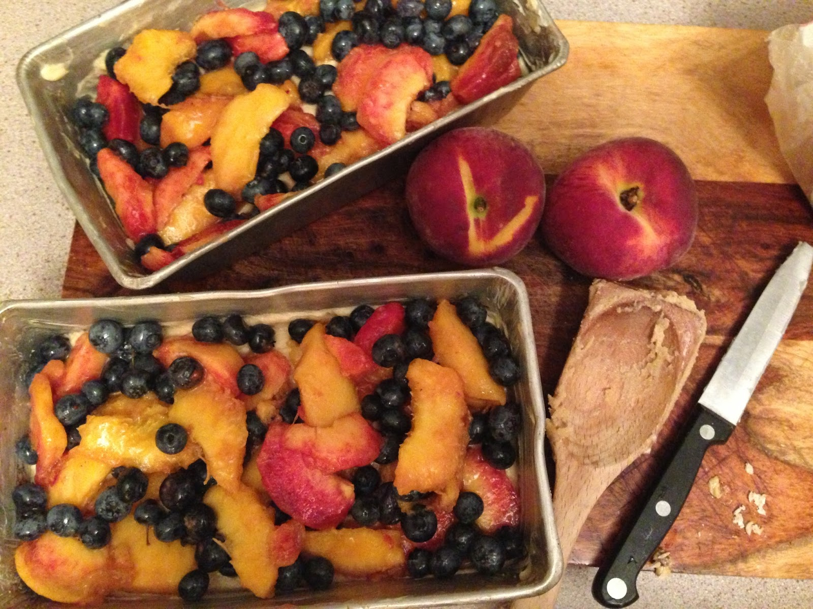 sprinkle peaches and blueberries evenly over the top right before