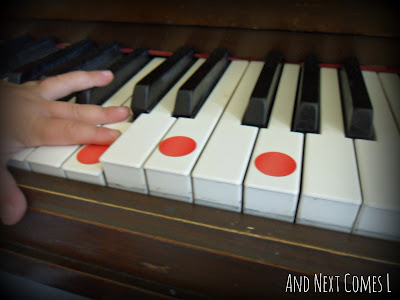 Playing chords on the piano using dot stickers from And Next Comes L