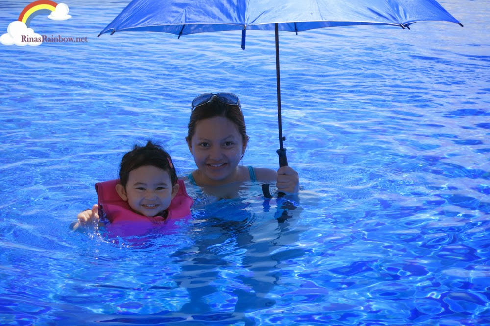 swimming with umbrella