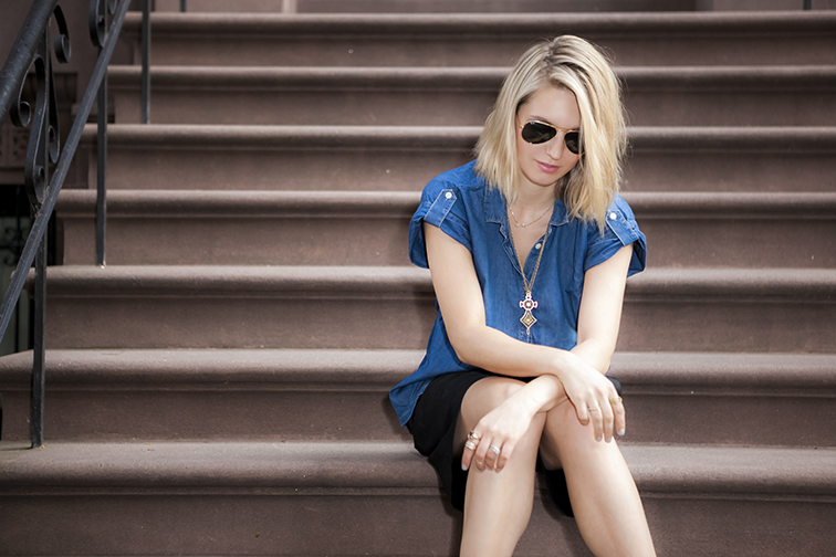 Chilling on the stoop of a brownstone, gold jewelry, denim and black outfit, New York City, messy blond hair