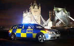 Police Car by Tower Bridge, in London, England