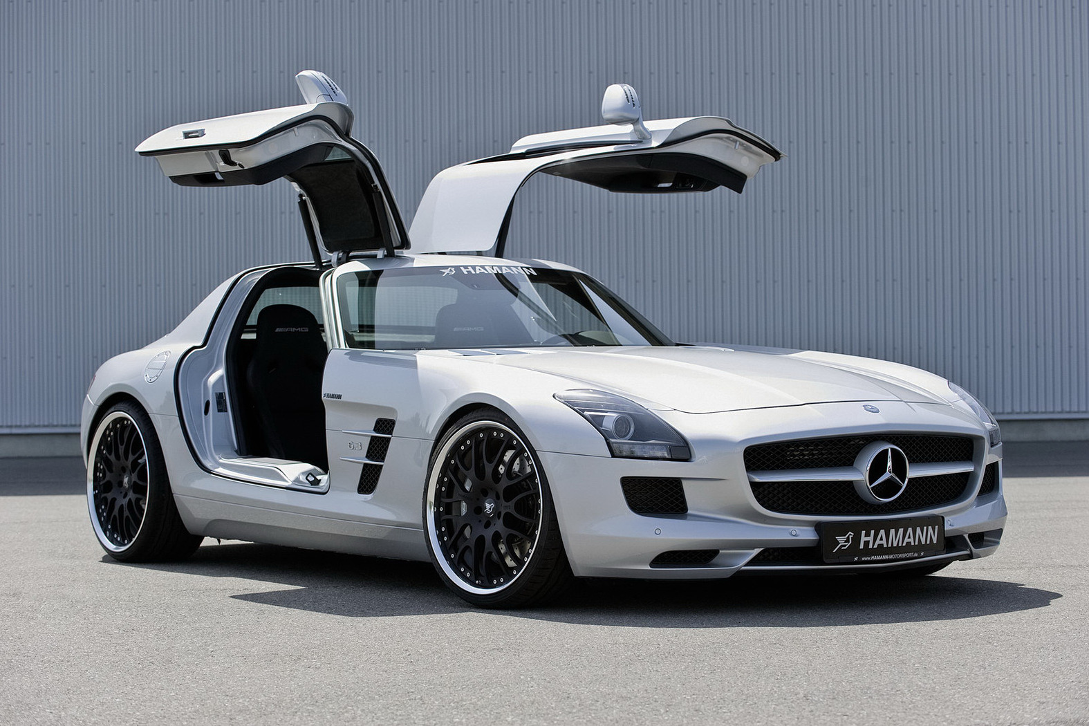 http://1.bp.blogspot.com/-IbUsOXhf0ys/TrEjjDQMg3I/AAAAAAAAFhY/hxiGLcS_Th8/s1600/Mercedes+SLS+AMG+3.jpg