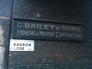 Old sign in Barbon Close, London WC1