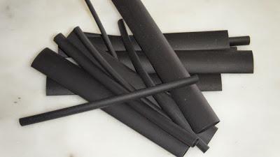 Manga retráctil preta de vários diâmetros