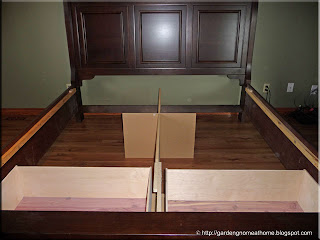 setting up the new bed frame in master bedroom