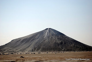 This is a 'Mud Volcano'. In Pakistan there are more than 80 active mud volcanoes, all of them in Baluchistan province; there are about 10 locations having clusters of mud volcanoes. In this region, the heights of mud volcanoes range between 800 to 1,550 feet (243.8 to 472.4 m). The most famous is Chandaragup.