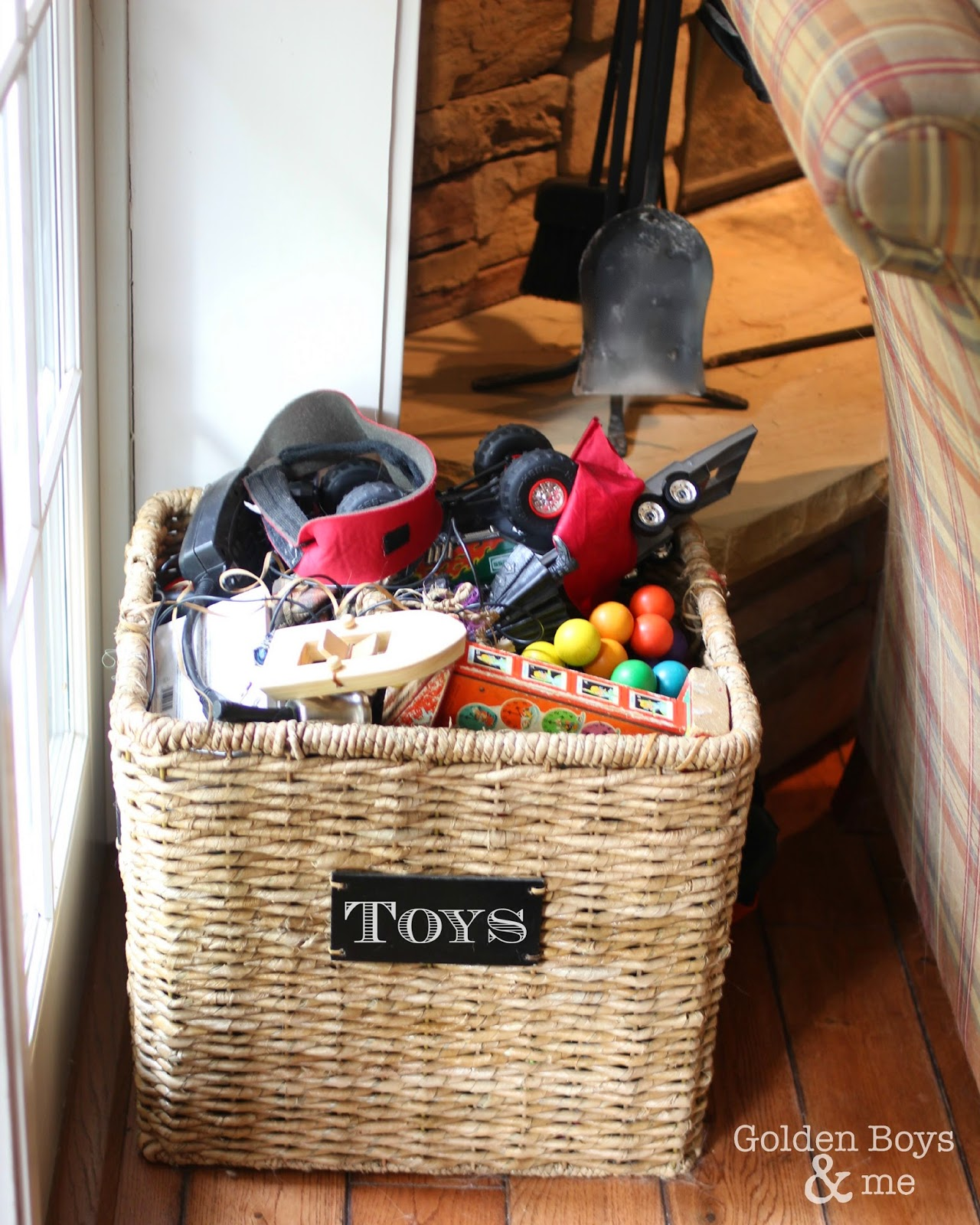 Target toy basket in family room for storage-www.goldenboysandme.com