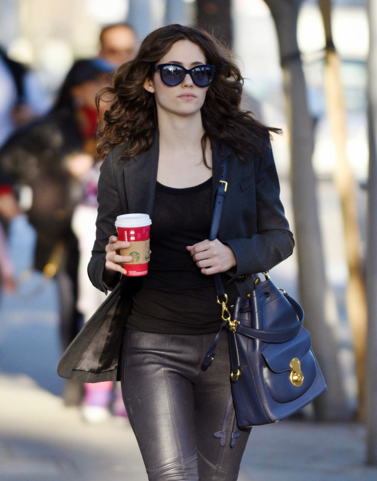 Emmy Rossum flaunts toned legs in leather trousers in LA