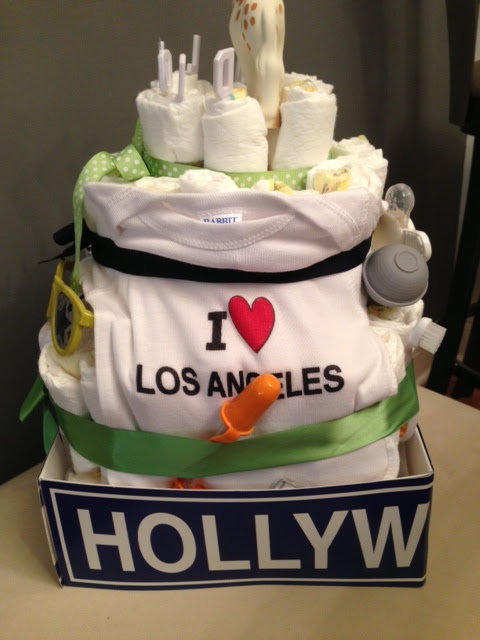 Side by side design diy la diaper cake the most fun part of creating this diaper cake was finding baby items to fit the theme we scoured amazon for just the right california inspired onesie publicscrutiny Image collections