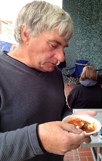 man eating chili and crackers