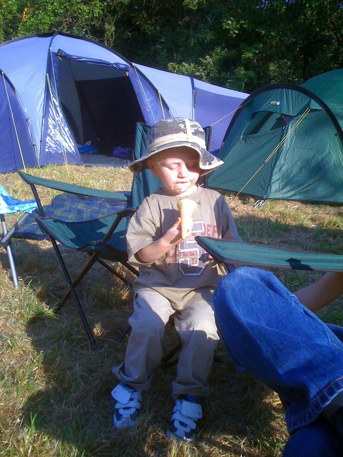 boy on campsite eating ice-cream