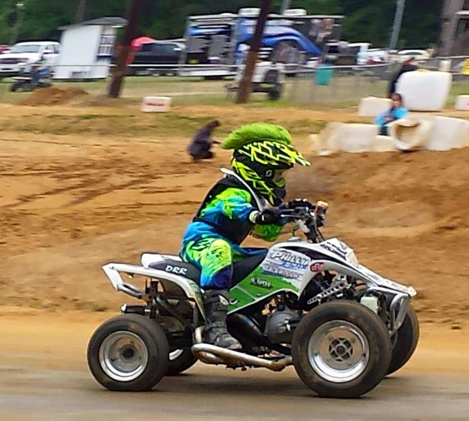 Kenny Phillips at the first 2 rounds of the series he runs, New East Extreme Dirt Track, at Kinston North Carolina. He runs in the 70cc and Super Mini classes on his DRR 70. He finished 2nd in the 70cc class and 4th in the super mini class in round one, and 1st in the 70cc class and 3rd in the super mini class in round 2. #DRR #DRRUSA #DRRracing , black, green, dirt, track,Kenny,70cc