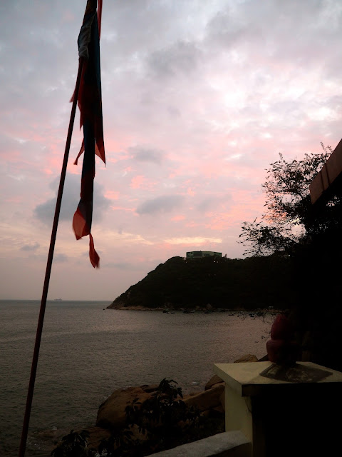 Flag silhouette at sunset outside Pak Tai Temple, Ma Hang Park, Stanley, Hong Kong
