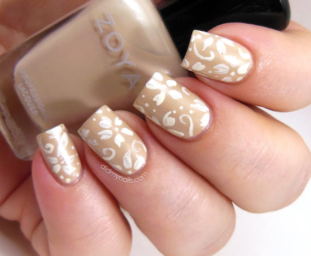 white flower nail art on Zoya Minka