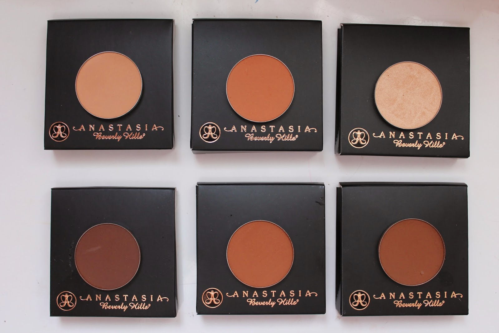 anastasia contour kit dark. top row: highlighting shades (left to right): golden peach, sandstone, champagne bottom contour carob, cinnamon, espresso anastasia contour kit dark