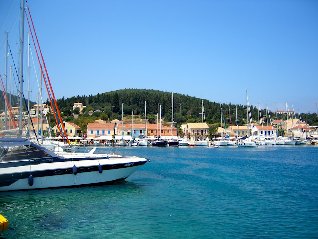 Boats on the ocean in the port of Fiskardo, Kefalonia, Greece
