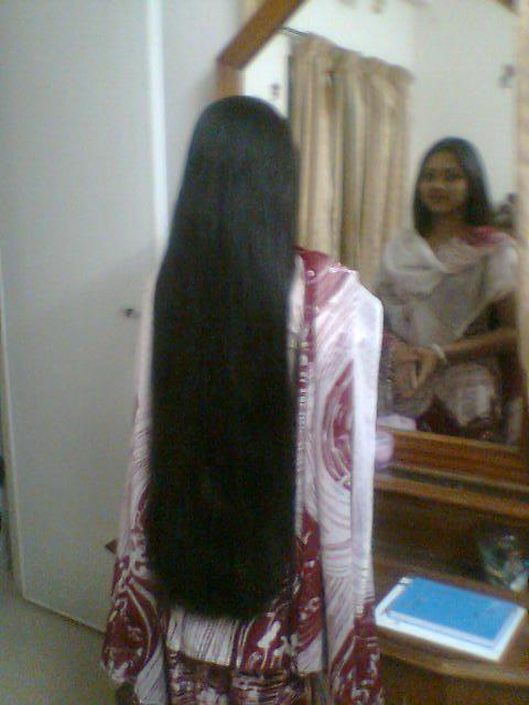 Prabha from chennai combs and styles her hair before going to college.