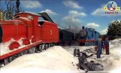 Edward blue engine pulled James train engine out the white deep snow on the cold chilly iron track