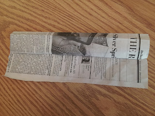 folded newspaper strip