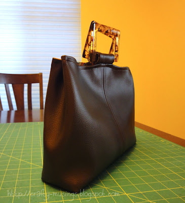 faux leather handbag, side view