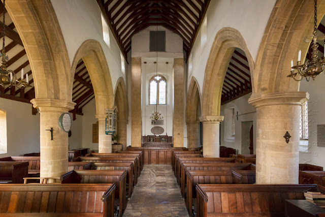 The interior of St Mary's church in the Cotswold village of Swinbrook by Martyn Ferry Photography