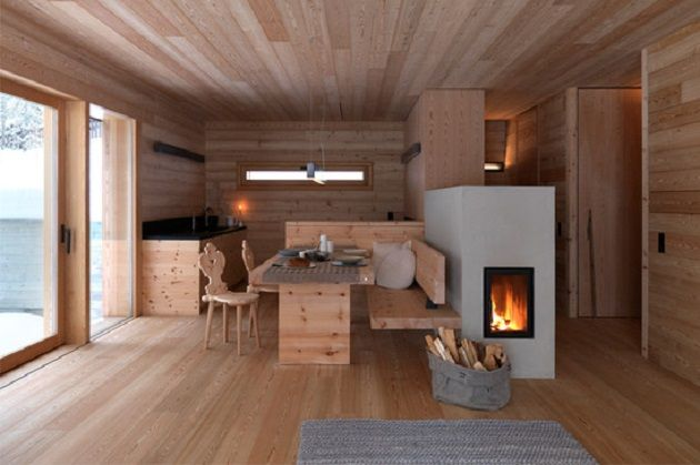 Modern minimalist Scandinavian kitchen with wood burning stove