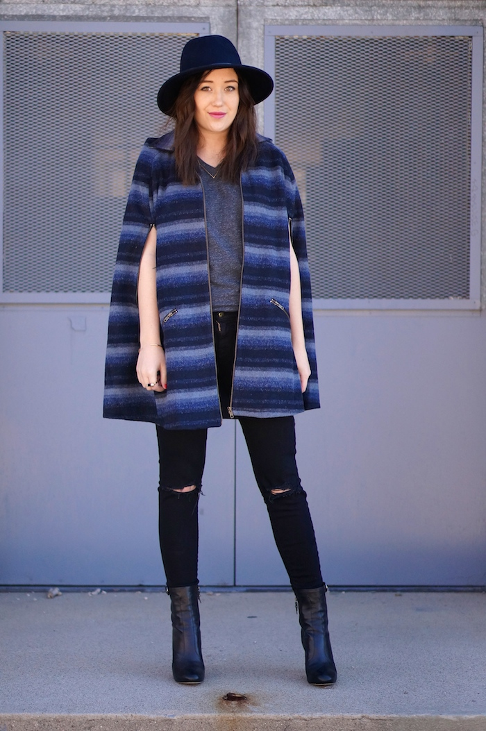 casual everyday outfit with a hat, cape and high heel ankle boots