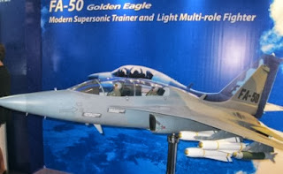 model of the FA50 jet fighter of South Korea is seen in the 2012 Air