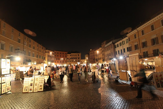 Paintings are sold at Piazza Navona in Rome, Italy