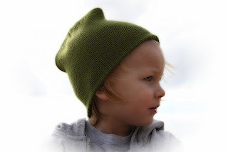 Portrait of a baby boy in a green hat, by Greyerbaby / Lisa Runnels